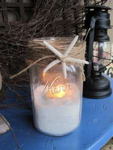 Mason jars filled with sand and a tealight candle. Wrapped in twine with a starfish accent.