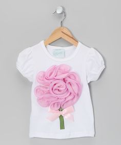 A marvelous ruffled floral embellishment sits in full bloom upon this precious tee, with a ribbon bow underneath for good measure. Made from a gentle cotton and spandex blend, this piece artfully combines style and casual comfort in a way that is guaranteed to brighten a little one's day. 97% cotton / 3% spandexHand wash; hang dry