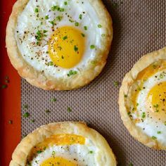 Cheesy Puff Pastry Baked Eggs with Frozen Puff Pastry Sheets, Large Eggs, Shredded Cheddar Cheese, Chopped Fresh Chives.