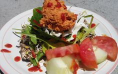 Raw Vegan Stacked Salad: Mauk Family Farms Raw Wheat-Free Crust topped with Organic Alflafa Sprouts, Organic Arugla, Organic Baby Spinach, Shredded Cabbage, Shredded Carrot, Organic Cucumber and Tomato from the family garden, and a scoop of Living Organic Sun-Dried Tomato Hummus drizzled with Huy Fong Hot Chili Garlic Sriracha Sauce