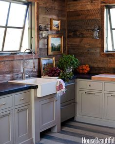 Both serviceable and handsome, this cabin-style kitchen designed by Megan Rice Yager — clad in reclaimed wood — is an inviting spot to warm up.   - HouseBeautiful.com