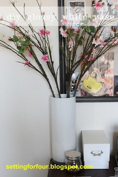 How to paint a clear vase to look like a designer glossy white one! Add some branches to create a gorgeous vignette!