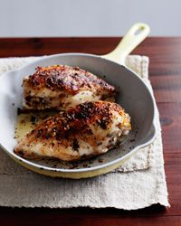 Grilled Chicken Breasts with Lemon and Thyme  - Quick Chicken from Food & Wine  A bold mixture of red-pepper flakes, garlic, thyme, lemon juice, and olive oil serves as a spicy marinade for bone-in chicken breasts. If you want your chicken spicier still, increase the red pepper or leave the breasts in the marinade for an hour or two.