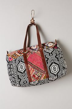 "Inspiration.  Leela Weekender - anthropologie.com.  21""l x 14"" w x 7"" h.  Zip close; 1 interior zip pocket.  Back is solid patterned fabric - no embroidered insert."