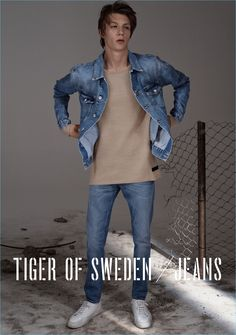 Finnlay Davis sports a denim jacket and oversized top with Tiger of Sweden blue slim jeans $270.