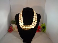 """Givenchy Faux Two Tone  Pearls and Goldtone Choker Necklace 16-17"""" www.CCCsVintageJewelry.com Free Shipping to the United States.  This necklace features the Givenchy logo and the faux pearls are both an off white or cream and a light pink."""