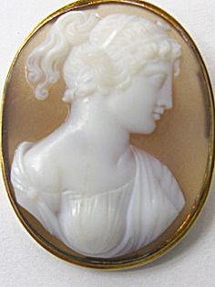 Sardonyx is a stone of strength and protection. Use it to enhance willpower, integrity, stamina and vigor.  Sardonyx/Ónice It is believed to bring lasting happiness and stability to marriage and partnerships. It attracts friends and good fortune.  photo of a ANTIQUE SARDONYX CAMEO PIN