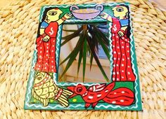 Handpainted mirror frame  madhubani  by The Far East Art Studio