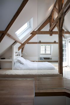 Photo by Olivier Chabaud Architecte – Discover rustic attic bedroom design inspiration. Stunning modern attic bedroom with wood floors and wood beams throughout.