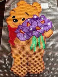 Winnie with flowers.