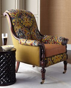 """""""Chamberlain"""" Chair by Old Hickory Tannery at Horchow. A study in contrasts, this handcrafted chair is an eclectic mix of wood, solid fabric,  crewel embroidery, and leather. Turned front legs and nailhead trim add to its charm. Crewel fabric is cotton with wool embroidery; solid fabric is linen. Leather seat cushion has foam/down core."""
