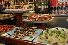 Pintxos in San Sebastian, Basque Country, Spain.  Basically tapas except they are often skewered with a toothpick to a piece of bread.
