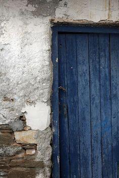 """Denim blue rustic painted door and grey wall with plaster and stone creates a modern colour scheme in a vintage setting. "" Natalie Fermoyle Photo credit: Wabi Sabi Mood Indigo, Azul Indigo, Bleu Indigo, Love Blue, Blue Grey, Blue And White, Windows And Doors, Old Doors, Cobalt"