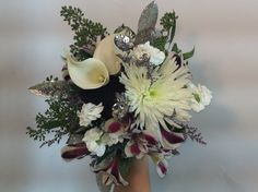 A great bouquet for a winter wedding a any bride who likes a little glitz! A Twigs and Vines Floral Original Design