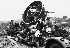 Chinese soldiers man a sound detector which directs the firing of 3-inch anti-aircraft guns against Japanese forces during the Second Sino-Japanese War 1941 [1000x1600]