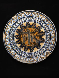 Roundel of tin-glazed earthenware, possibly made in Faenza, Italy, about 1475. | V&A Search the Collections
