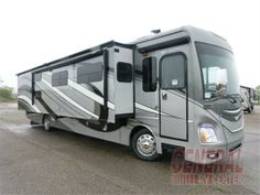 """Click to enlargThe 40G Discovery motor home by Fleetwood features a full wall slide. Stepping inside this motor home you will notice how open and roomy it feels. The wall slide has a free-standing dinette, sofa with air mattress, bunk beds, nightstands, and king bed with memory foam. The bedroom also has a rear wardrobe and stackable washer and dryer, and a 32"""" LED tv.e"""