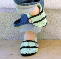 Mint and black crocheted slippers, booties, shoes, socks with a button strap.. $20.00, via Etsy.