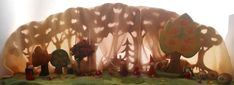 In addition to our, recently published, Nature Table for September, we've also completed our Autumn Season table. We have added variety of little people to complete the scene. Elves made from felt...