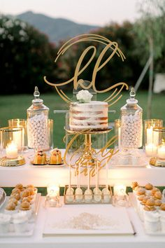 This stunning destination wedding in Greece is brimming with milk-white hydrange. This stunning destination wedding in Greece is brimming with milk-white hydrangeas and peonies with touches of gold Wedding Candy Table, Dessert Bar Wedding, Wedding Desserts, Wedding Cakes, Elegant Dessert Table, Sweet Table Wedding, Cake Tables For Weddings, Gold Dessert Table, Wedding Cake Table Decorations