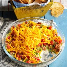 Layered BLT Dip Recipe -When I throw a party for friends, I whip up this addictive layered three-cheese dip. Somehow, it's always gone within the first 20 minutes. —Jade Bennett, Kingwood, Texas