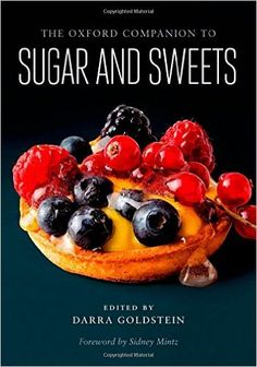 """More than just a compendium of pastries, candies, ices, preserves, and confections, this reference work reveals how the human proclivity for sweet has brought richness to our language, our art, and, of course, our gastronomy. In nearly 600 entries, beginning with """"à la mode"""" and ending with the Italian trifle known as """"zuppa inglese,"""" the Companion traces sugar's journey from a rare luxury to a ubiquitous commodity."""