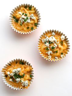 Mac and cheese is always a hit but can get a little messy in a party setting. Serve up single portions in cupcake liners for a crowd-friendly snack. #buffalochicken #superbowl