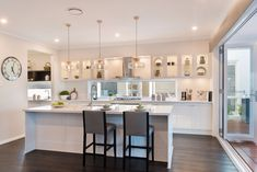 Clear glass overhead cupboards and profiled joinery has inside the St Clair pays tribute to the traditional influence of the Hamptons style.    #mcdonaldjoneshomes #mcdonaldjones #hamptonsinspired #butlerspantryideas #kitchendecor #kitchenideas