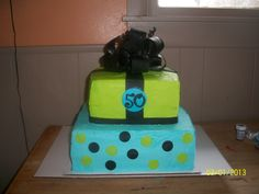 - 50th birthday cake with gumpaste bow and fondant accents