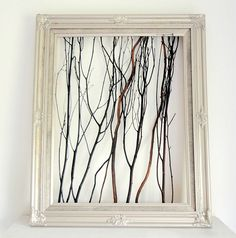 Who knew a handful of twigs could look so...elegant? This gorgeous DIY frame adds a touch of nature to your mantel.