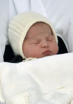 The new baby princess was fast asleep as she was first introduced to the world...