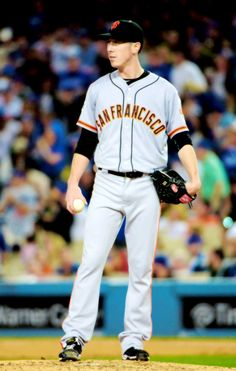 Tim Lincecum #55 of the San Francisco Giants pitches in the first inning against the Los Angeles Dodgers during the MLB game at Dodger Stadium on April 27, 2015 in Los Angeles, California.