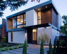 Двухэтажный дом с большими окнми