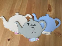 A personal favourite from my Etsy shop https://www.etsy.com/uk/listing/551449201/hand-painted-wooden-teapot-table-numbers