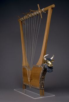 Queen's lyre, Sumerian, about 2600-2400 BC. Lapis lazuli, shell, red limestone, and gold.