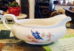 Wouldn't this be great to serve gravy from at Thanksgiving? It's the little things! VINTAGE Bluebird Gravy Serving Pitcher...SistersGardenIowa on Etsy...