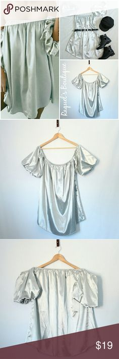 Amber Silky Dress in Silver Details: Silky off the shoulder puffy sleeve dress with curved hemline  Brand: Boutique Brand  Size: Medium Measurements: Bust/38-40 inches Length/26.5 inches  Size: Large Measurements: Bust/40-42 inches Length/27 inches  Condition: New and packaged Dresses