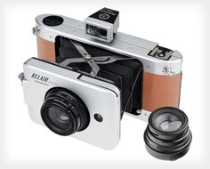 Lomography have introduced the world's first ever 6 x 12 auto-exposure medium format camera - the Belair X Jetsetter. Bringing a new level of lens quality to Lomographers, the camera combines all the features of a panoramic medium format camera Old Cameras, Vintage Cameras, Antique Cameras, Canon Cameras, Tech Gifts For Dad, Folding Camera, Photo Deco, Medium Format Camera, Square Photos