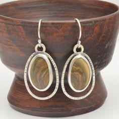 These all sterling silver earrings feature a pair of royal sahara jasper cabochons in shades of earthy brown. These stones are bezel set and are framed by textured sterling silver. These earrings have been oxidized and brushed to highlight the texture. The earrings measure about 1 3/4 inch long including the sterling silver ear wire, and about 3/4 inch wide. The earrings have been stamped with my makers mark. Please read my shipping and policies page on the tab above or at this lin...