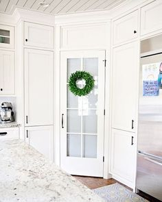 Floor to ceiling white cabinets, tongue and groove ceiling, windowed pantry door #homesweethome  www.beehivestatebuilders.com