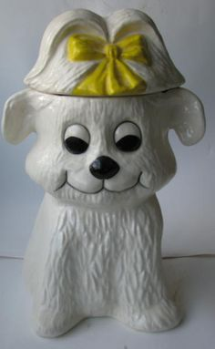 Puppy with yellow bow on Collectors Quest