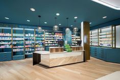 Farmacia Centrale by AMlab, Arcore – Italy Shoe Store Design, Retail Store Design, Visual Merchandising, Reception Desk Design, Reception Counter, Pharmacy Store, Bedroom Door Design, Restaurants, Showroom Design