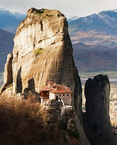 "8 Places to Visit in Greece-Meteora-This complex of six monasteries built inside natural rocks is just too surreal to describe but I'll try to do my best to explain why Meteora is one of the must-do's for anybody considering places to visit in Greece. First of all, there is a lot of history involved, so much I doubt I'll have enough time and space to explain here, then you have the ""wow"" effect of the foggy, mystical landscape and, by the time you finally manage to climb all those steps."