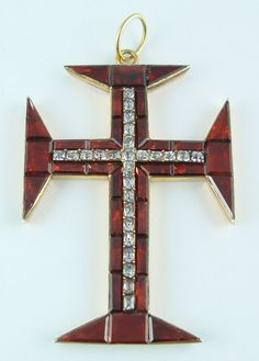 Cross of the Portuguese Order of Christ - 18th century -   Silver set with foil-backed garnets and colorless crystals known in Portugal as minas-novas.  According to Lewis, the Portuguese rarely, if ever, used paste.  See M.D.S. Lewis, Antique Paste Jewellery plates 18 and 22.  Bail is not original.