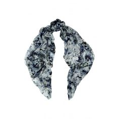 Worn by Duchess Catherine on Royal Tour. Beulah's modal and cashmere- blend scarf is equal parts elegant and playful. Printed with pastel blues, this lightweight design can be wrapped around your neck or draped loosely over the shoulders.