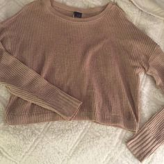 Sparkle and Fade crop sweater Tan crop sweater from urban outfitters. Brand is Sparkle and Fade. Size Medium. Goes great with a high wasted maxi skirt or jean shorts and a great statement necklace Sparkle & Fade Sweaters Crew & Scoop Necks