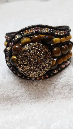 Check out this item in my Etsy shop https://www.etsy.com/listing/221066691/boho-style-beaded-cuff-leather-wrap