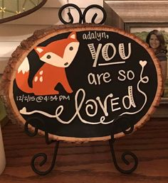 Hand painted wood slice chalkboard for the woodlands theme nursery. The parents used this chalkboard to write a beautiful message to their little one. Hand painted and designed by J. Bell at The Palette Sphere