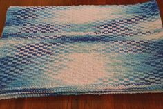 This easy baby blanket looks more dramatic than it is thanks to the use of simple slip stitches with the yarn in front to make a ladder-like pattern that adds texture to Stockinette Stitch.