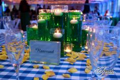 Emerald City centerpieces with Gingham linen and yellow brick rose petals.    minus the candles? I do feel like the candles really make this look pretty though.